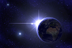 The Star. A shining star behind Earth Stock Image