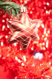Star. Red christmas star on red shiny background Royalty Free Stock Photography