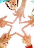 Star. Photo of joyful children making star by their finger Stock Photos