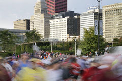 Star of 2009 Chicago Marathon with blur of runners Royalty Free Stock Images