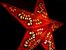 Star. Bright red star cutout lamp stock photography