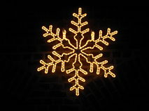 Star in Advent. Star in front of a brick wall Royalty Free Stock Images