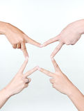STAR All for one by four hands. Star made from four people making and do it like as Star Stock Photography