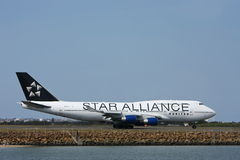Star Alliance United Boeing 747 on runway. Star Alliance United Airlines Boeing 747 jet on the runway Stock Photo