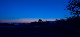 Free Star And Moon Twillight Countryside Landscape Royalty Free Stock Photography - 45860237