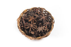 Star Anis into a Basket. Isolated on white background Royalty Free Stock Photo