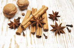Star anis, cinnamon stick, walnut and cloves. On a wooden background royalty free stock photo