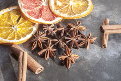 Star anis, cinnamon sticks, orange and dry fruits Royalty Free Stock Images