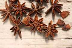 Star anise. On a wooden table Stock Photos