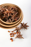 Star anise. Graup o Star anise spice, with seeds and ceramic bowls Royalty Free Stock Images