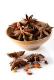 Star anise. Group of Star anise spice, with seeds, in ceramic bowls and isolated background Royalty Free Stock Image