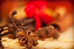 Star anise. And peeled almonds with cinnamon in the back royalty free stock images