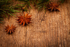 Star anise and branch on wooden background Royalty Free Stock Images