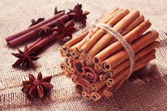 Star anise and bunch of cinnamon on a sackcloth Royalty Free Stock Images