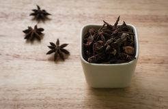 Star anise in ceramic container royalty free stock images