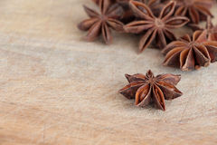 Star anise on a chopping board Royalty Free Stock Images