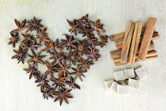 Star anise , cinnamon and brown sugar cubes Royalty Free Stock Photography