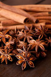 Star anise and cinnamon close up on wooden table Stock Images