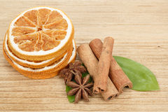 Star Anise, cinnamon and dried orange wooden background Royalty Free Stock Images