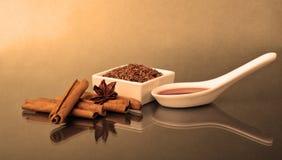 Star anise, cinnamon and flax Royalty Free Stock Photos