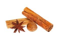 Star anise cinnamon and nutmeg. Star anise, cinnamon and nutmeg isolated against white royalty free stock photography