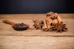 Star anise and cinnamon stick,black pepper. Star anise and cinnamon stick with black pepper on wooden board background,Chinese star aniseed Stock Images