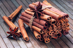 Star anise and cinnamon sticks in a bunch on a wooden background Stock Images