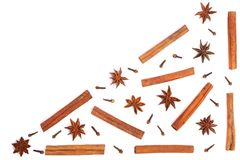 Star anise, cinnamon sticks and clove isolated on white background with copy space for your text, pattern flat lay Stock Images