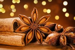 Star Anise And Cinnamon Sticks With Dark Bokeh Background stock image