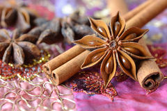 Star anise and cinnamon sticks. Over indian carpet Royalty Free Stock Image