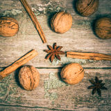 Star anise, cinnamon sticks and walnuts Royalty Free Stock Photography