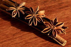 Star anise and cinnamon. Sticks on a wood background Royalty Free Stock Images