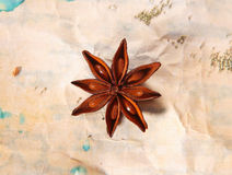 Star anise on crumpled paper Royalty Free Stock Photo