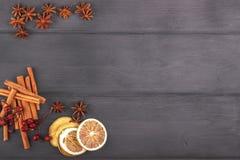 Star anise, dried lemon, cinnamon. Top view on wood, copy s. Star anise, dried lemon, cinnamon. Top view on dark wood, copy space Stock Photos