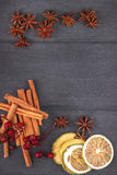 Star anise, dried lemon, cinnamon. Top view on wood, copy space. Star anise, dried lemon, cinnamon. Top view on dark wood, copy space Royalty Free Stock Photography