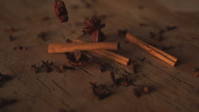 Star anise falling on table stock footage