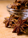 Star Anise in the Glass Bowl on Wooden Table Royalty Free Stock Image