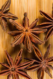 Star Anise, Illicium verum on a wood background. Close up. Stock Photos