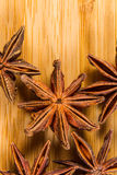 Star Anise, Illicium verum on a wood background. Close up. Royalty Free Stock Image