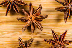 Star Anise, Illicium verum on a wood background. Close up. Royalty Free Stock Images