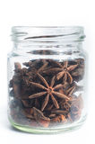 Star Anise in a jar. Isolated on a white background royalty free stock photo