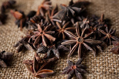 Star Anise. Macro random Star Anise on burlap stock photo