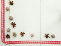 Star anise nutmeg and checked red ribbon Royalty Free Stock Photo