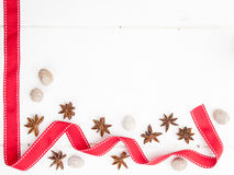 Star anise nutmeg and red ribbon Stock Photography