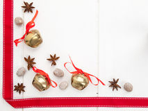 Star anise and nutmeg with red ribbon and sleigh bells Stock Photo