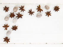 Star anise and nutmeg on a rustic white table top Stock Photo