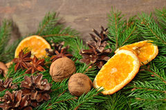 Star anise, nuts, cones, dried oranges and spruse branch Royalty Free Stock Photos