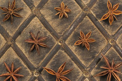 Star anise on old wood. Ornament of anise stars on old wood Stock Photos