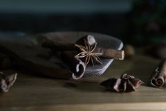 Star Anise and other Ingredients In a Wooden Spoon. Star Anise and other Baking Ingredients In a Wooden Spoon Stock Images