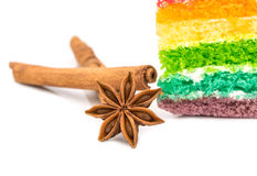 Star anise with rainbow cake isolated on white background royalty free stock image